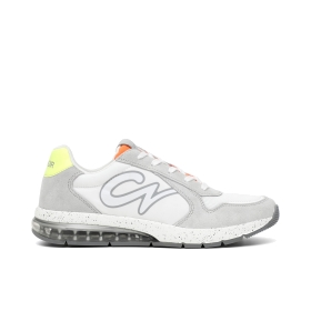 Athletic fabric and suede leather shoe with logo on the side and fluorescent tongue