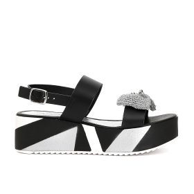 Double strap sandals with decorative wedge
