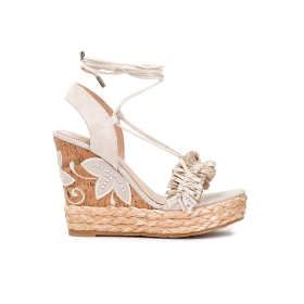 Sandals with tassels and rhinestones on the strap on raffia and embroidered cork wedge