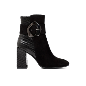 Dual material ankle boots with asymmetric buckle