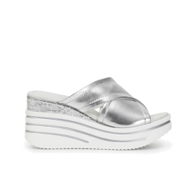 Slip-on shoes with crossover patent leather wedge